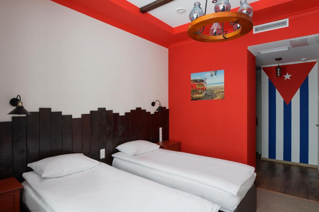 Кровать или кровати в номере Welcome House Boutique Hotel