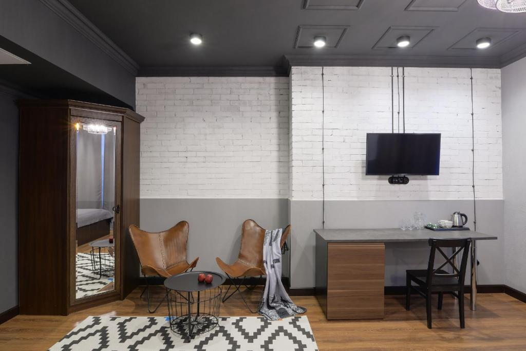 Телевизор и/или развлекательный центр в Welcome House Boutique Hotel