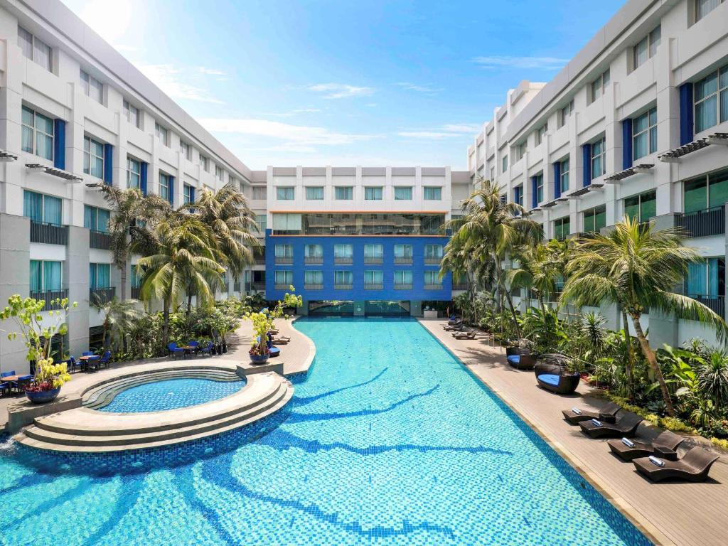 The swimming pool at or near Novotel Jakarta Mangga Dua Square