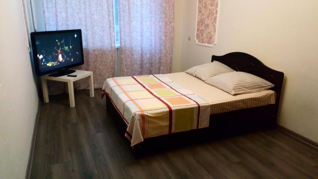 Кровать или кровати в номере Апартаменты на Лунной