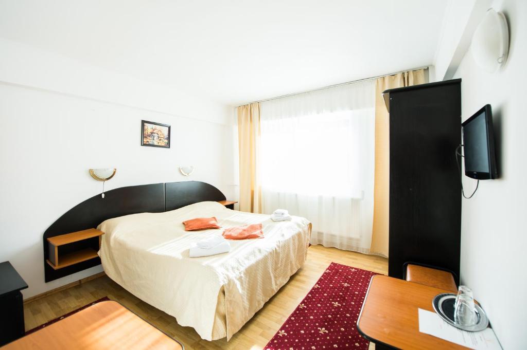 Un pat sau paturi într-o cameră la Gura Diham