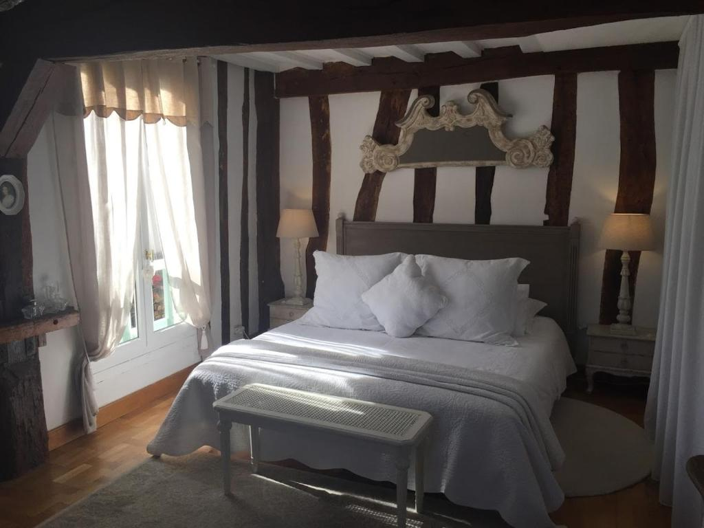 A bed or beds in a room at B&B les Agapanthes