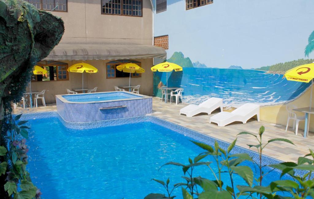 The swimming pool at or near Hotel Pousada Portal da Palmeira