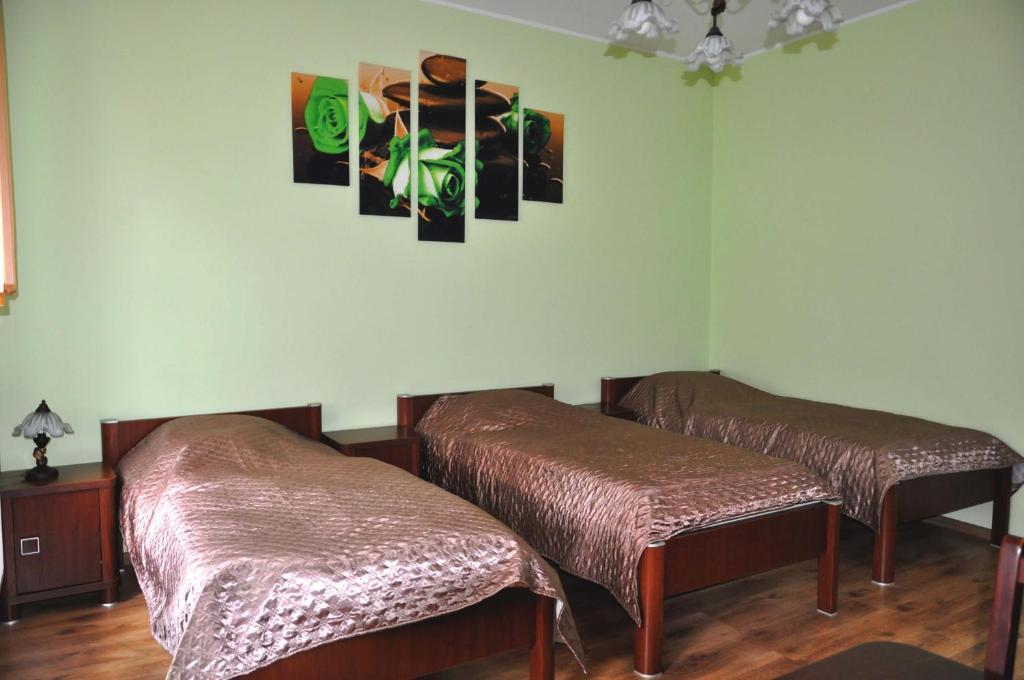 Łóżko lub łóżka w pokoju w obiekcie Apartament Przy Deptaku