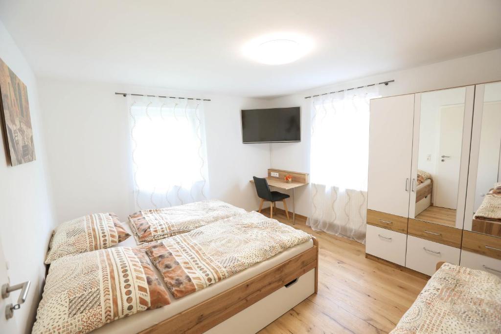 Ein Bett oder Betten in einem Zimmer der Unterkunft Villa Mozart
