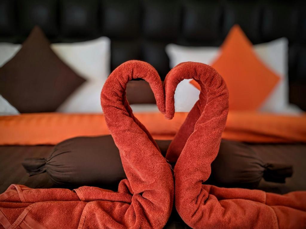 Ліжко або ліжка в номері Anbat Midtown Hotel