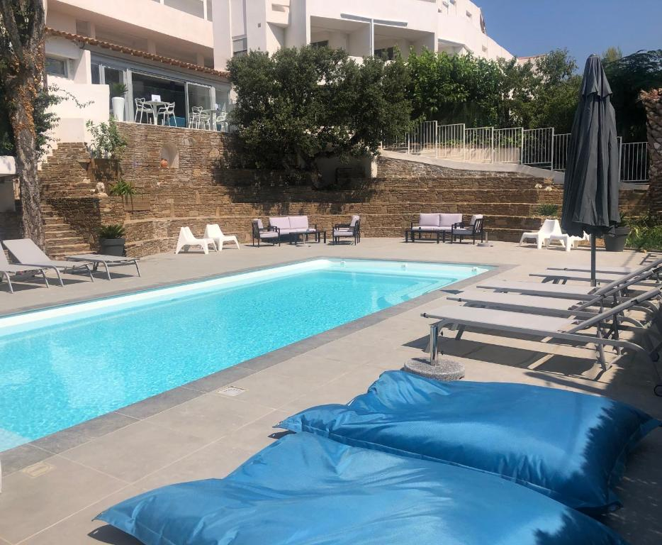 The swimming pool at or near Hotel La Voile