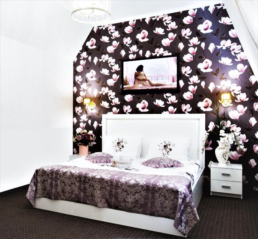 Кровать или кровати в номере Бутик-Oтель Прованс