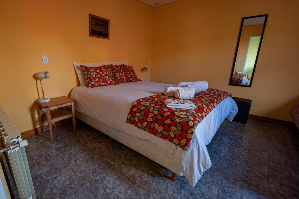 Una cama o camas en una habitación de Apart Guillaumet