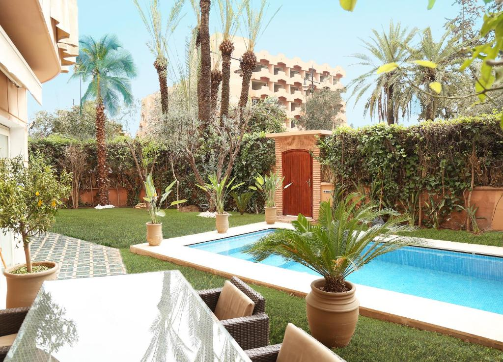The swimming pool at or near Stunning 4 Bed Luxury L'Hivernage The Ruby