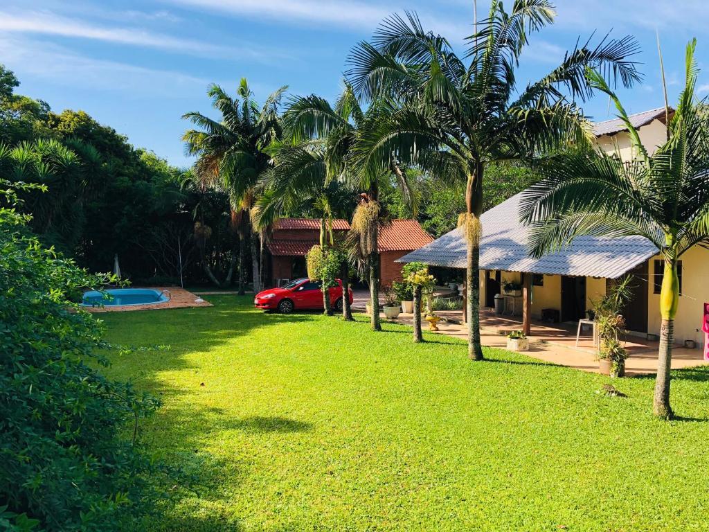 A garden outside Lindo sítio próximo a Porto Alegre