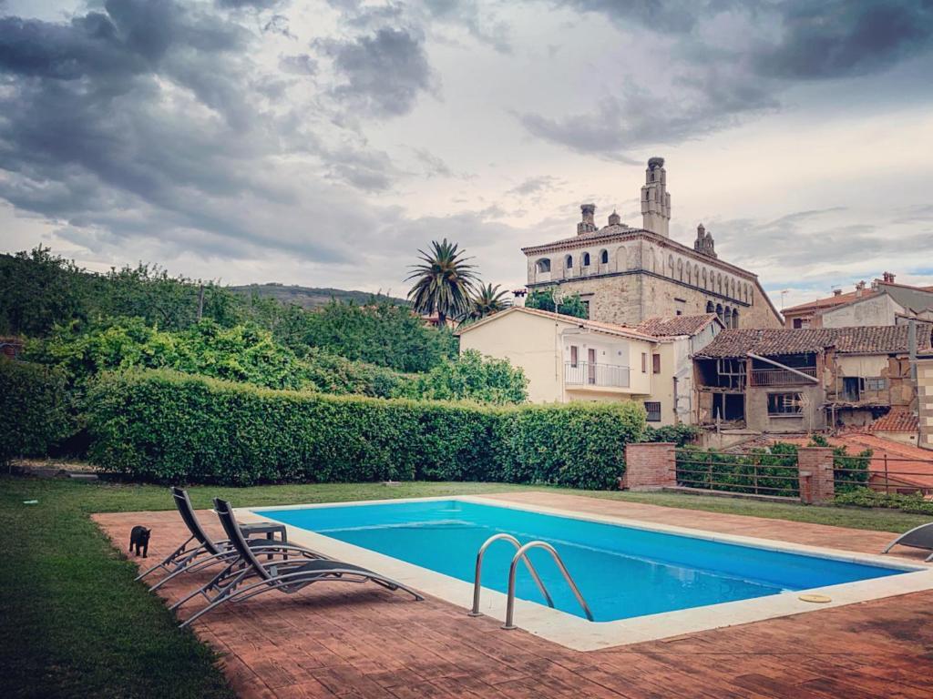 The swimming pool at or near Hotel Rural La Casa De Pasarón