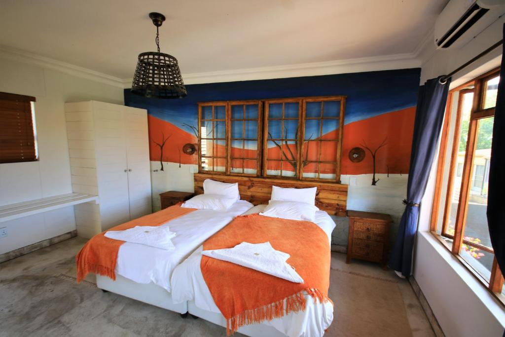 A bed or beds in a room at Windhoek Gardens Boutique Hotel