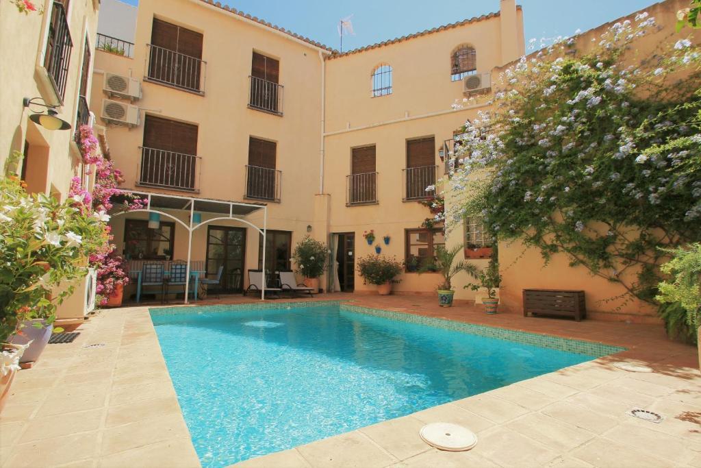 Het zwembad bij of vlak bij Casa del Patio