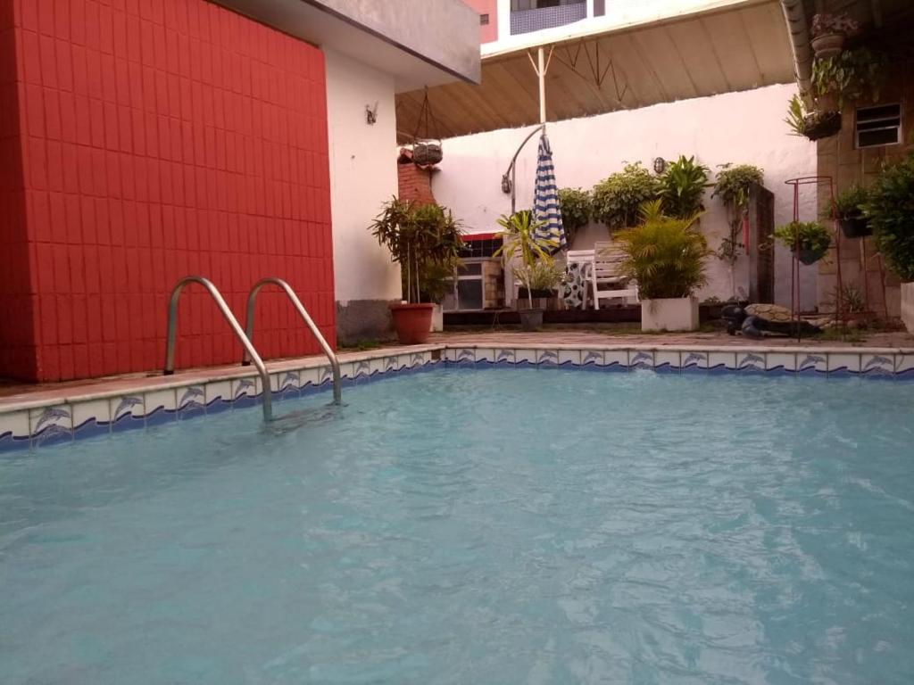 The swimming pool at or near Casa 135 - Recife