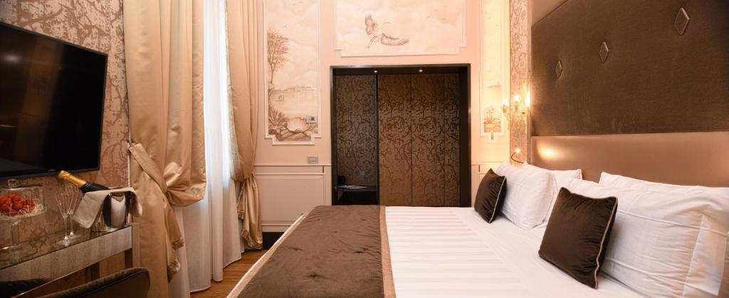 Cama ou camas em um quarto em Santa Croce Boutique Hotel