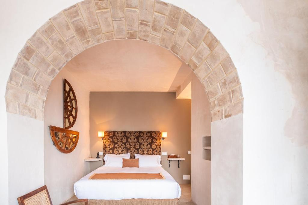 A bed or beds in a room at V... Boutique Hotel