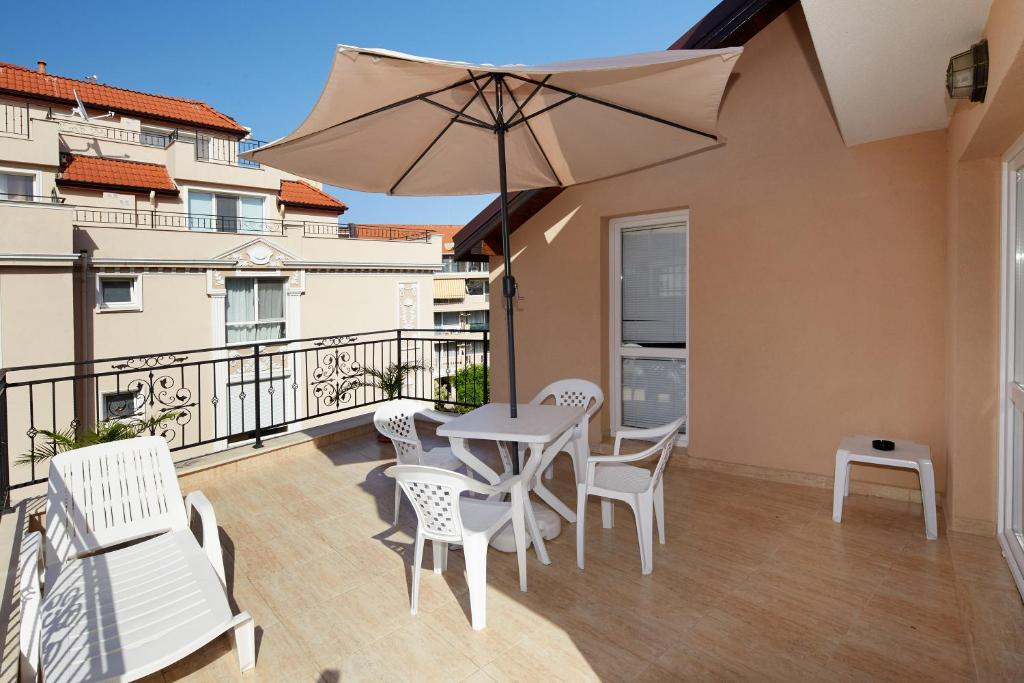 Балкон или терраса в Feniks Apartments