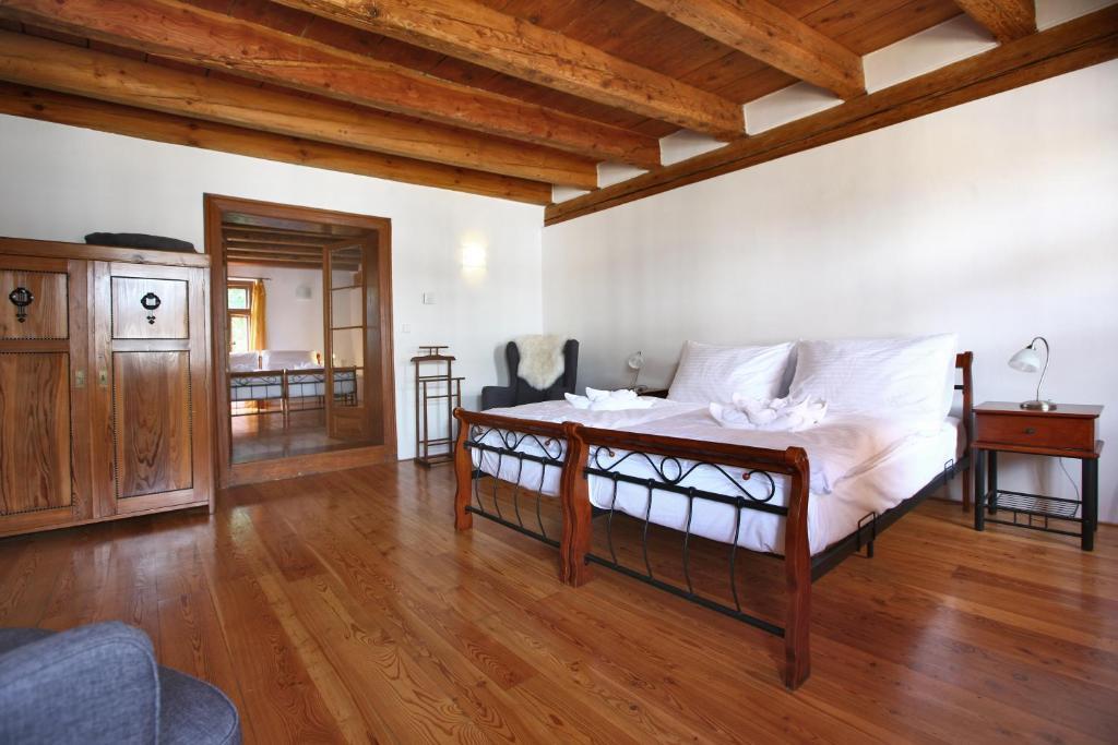 Postel nebo postele na pokoji v ubytování Royal Pension