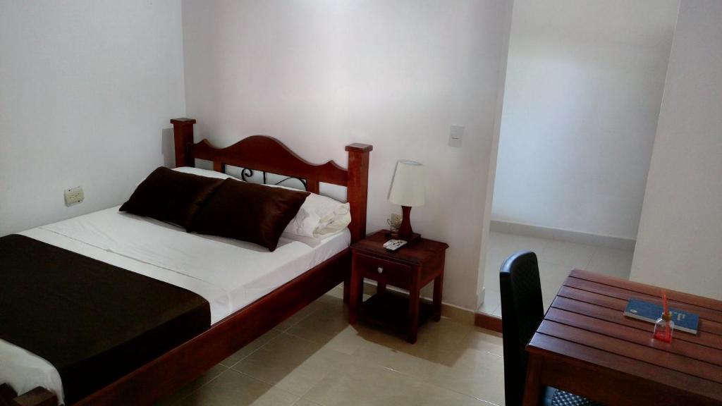 A bed or beds in a room at La Casona de Juancho