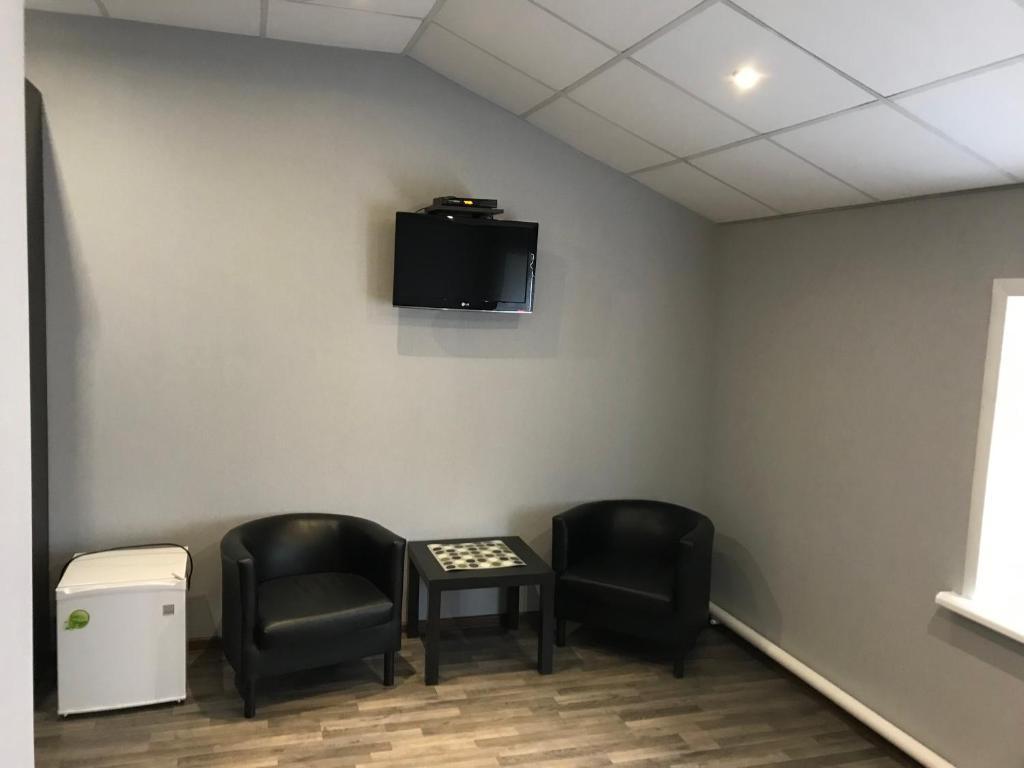 Телевизор и/или развлекательный центр в Отель Привал