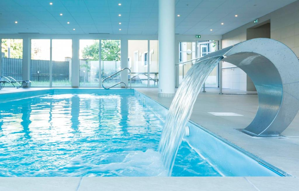 The swimming pool at or near Odalys City Colmar La Rose d'Argent