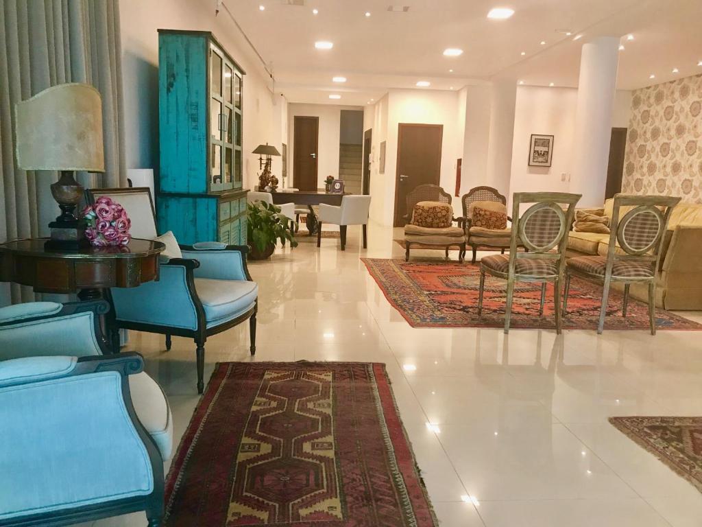 The lobby or reception area at Suítes Trindade