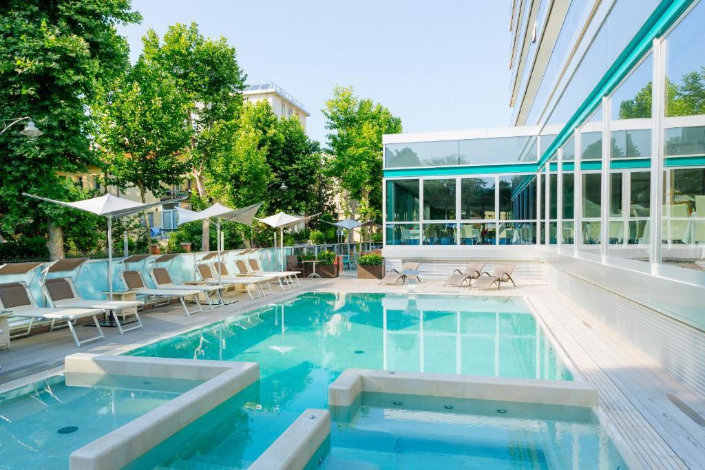 The swimming pool at or near Aqua Hotel