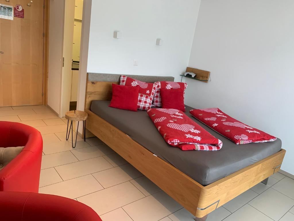 Ein Bett oder Betten in einem Zimmer der Unterkunft Ustria / Pensiun Trutg