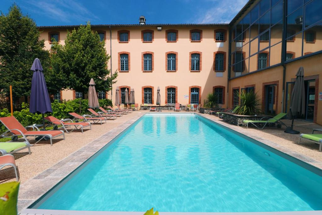 The swimming pool at or near Abbaye des Capucins Spa & Resort