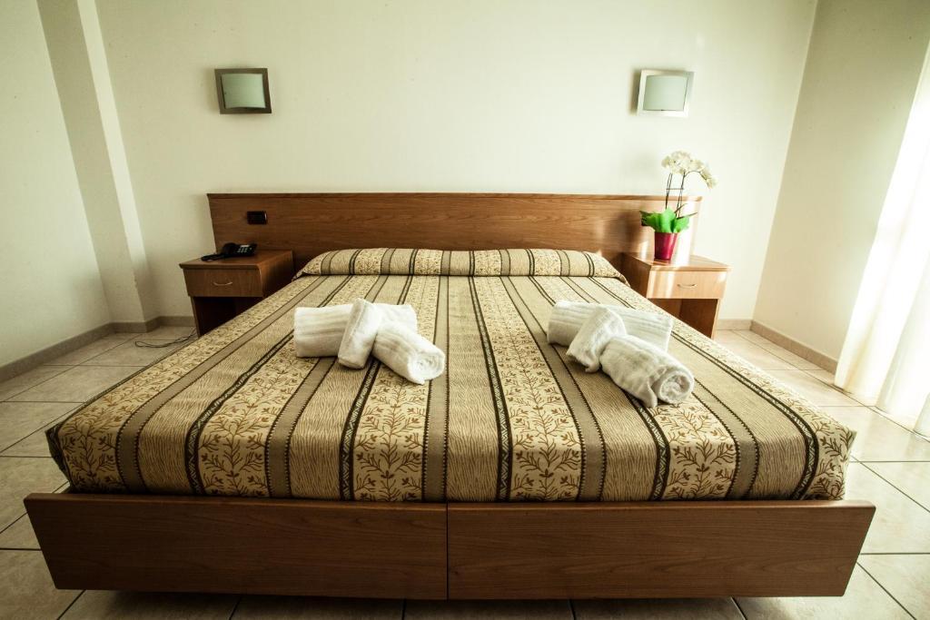 Letto o letti in una camera di Hotel Davide