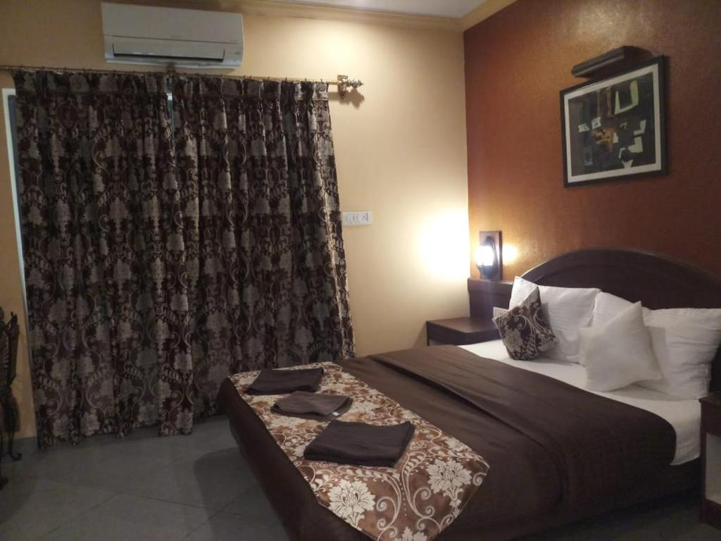 A bed or beds in a room at Goa Imperial Boutique