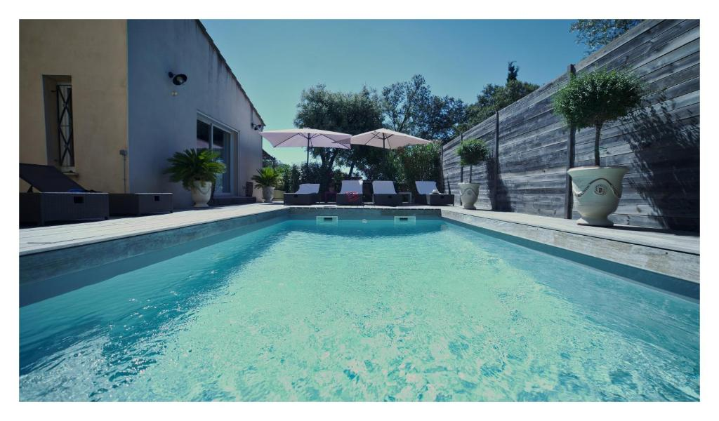 The swimming pool at or near Le Relais des Capitelles