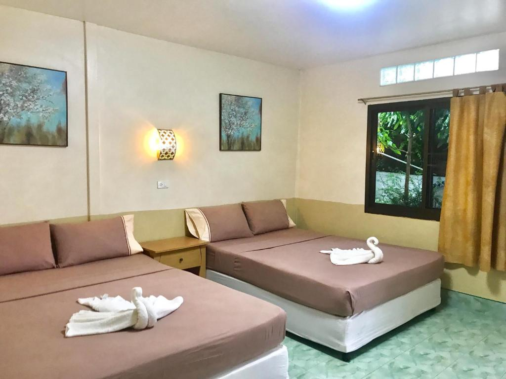 A bed or beds in a room at Coco's Guest House