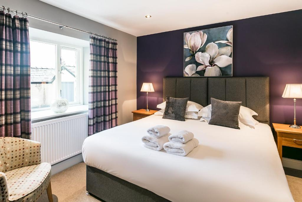 A bed or beds in a room at The Lodge @ Carus Green