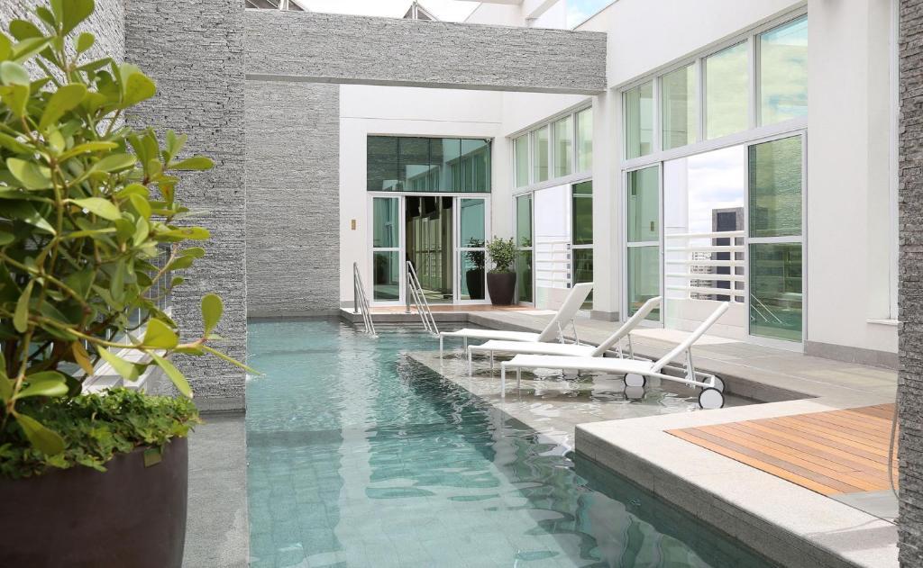 The swimming pool at or near Hotel Cadoro São Paulo