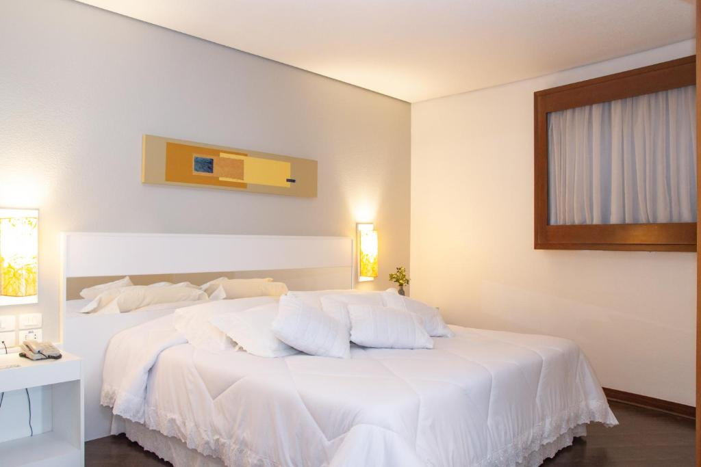 A bed or beds in a room at Bristol Brasil 500 Hotel