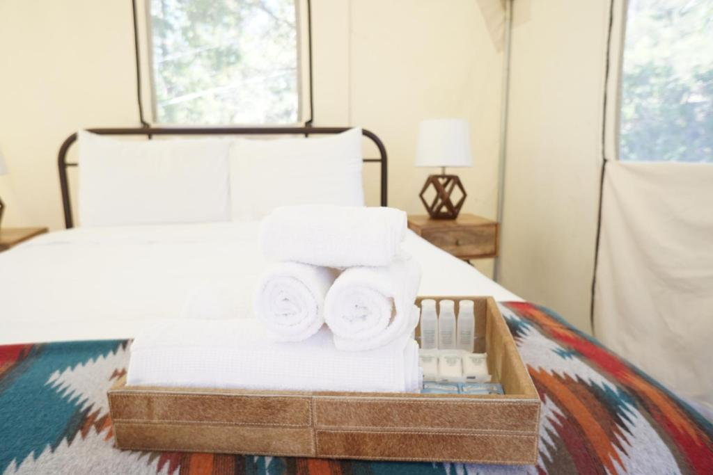 A bed or beds in a room at Shaver Lake Village Hotel