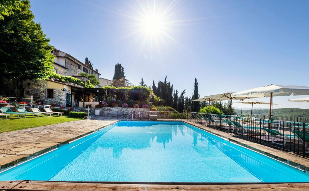 The swimming pool at or near Relais Vignale & Spa