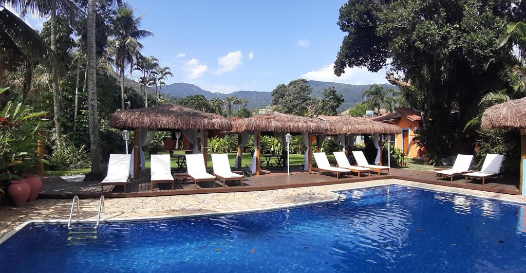 The swimming pool at or near Pousada Canoa Caiçara