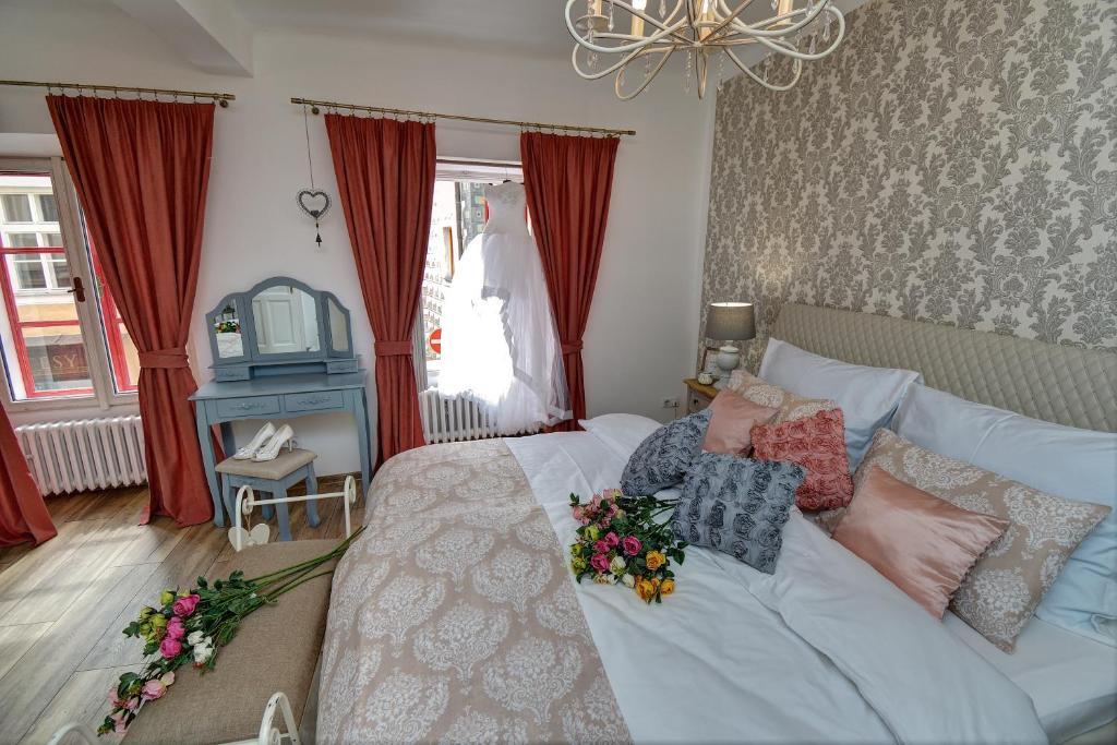 Postel nebo postele na pokoji v ubytování Křišťanka - kouzelné apartmány