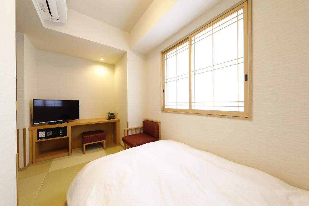 A bed or beds in a room at Onyado Nono Asakusa Natural Hot Spring