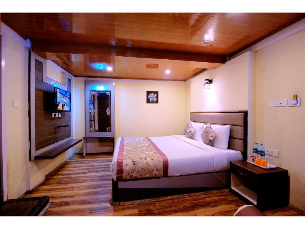 A bed or beds in a room at Udaan Olive Hotel & Spa, Pelling