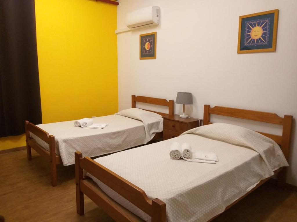 A bed or beds in a room at HI Faro – Pousada de Juventude