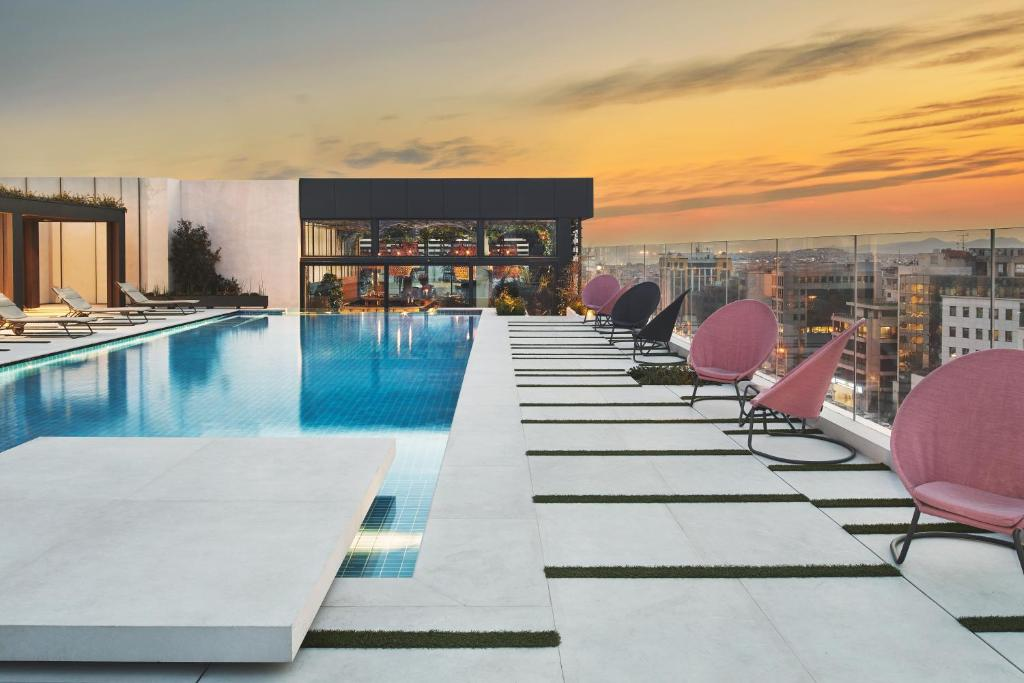 The swimming pool at or near Grand Hyatt Athens