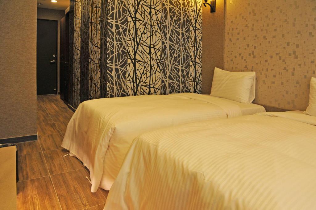 楓華沐月飯店 房間的床