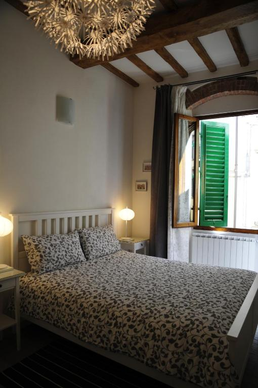 A bed or beds in a room at Conte Canacci