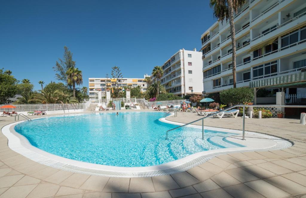 Piscina en o cerca de Apartamento Aloe 2 dormitorios 4P piscina wifi by Lightbooking