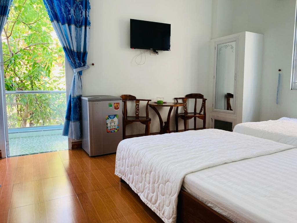 Giường trong phòng chung tại Mien Trung Hotel