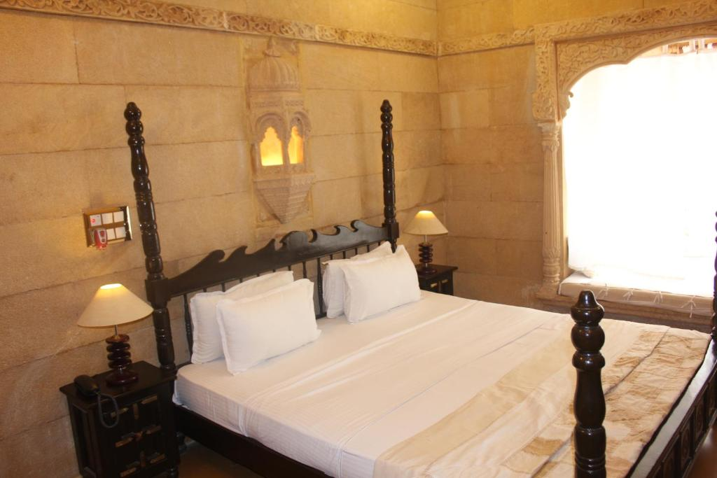 A bed or beds in a room at Hotel Pleasant Haveli - Only Adults